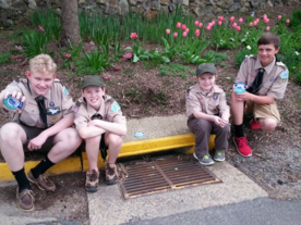 Boy Scout Troop Installing Medallions on Town Storm Water Drains